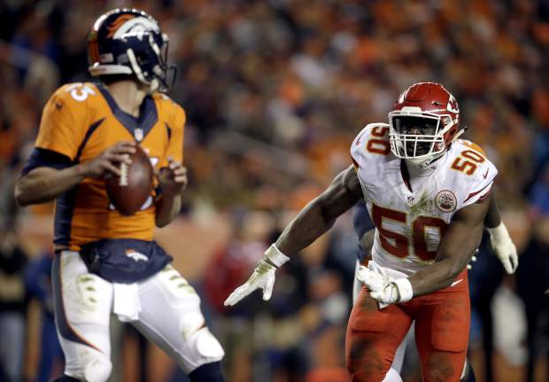 Kansas City Chiefs outside linebacker Justin Houston (50) prepares to sack Denver Broncos quarterback Trevor Siemian (13) in the end zone for a safety during the first half of an NFL football game, Sunday, Nov. 27, 2016, in Denver. (AP Photo/Joe Mahoney)