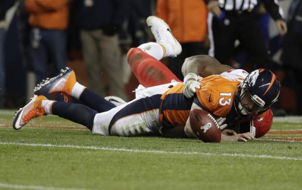 Kansas City Chiefs outside linebacker Justin Houston (50) sacks Denver Broncos quarterback Trevor Siemian (13) in the end zone for a safety during the first half of an NFL football game, Sunday, Nov. 27, 2016, in Denver. (AP Photo/Jack Dempsey)