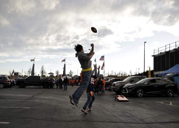Denver Broncos fans throw a football at Mile High Stadium prior to an NFL football game against the Kansas City Chiefs, Sunday, Nov. 27, 2016, in Denver.(AP Photo/Jack Dempsey)