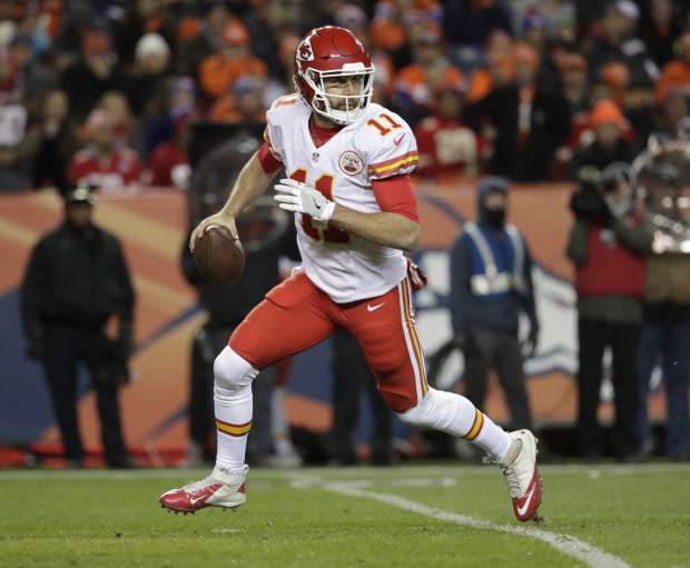 Kansas City Chiefs quarterback Alex Smith (11) looks to throw against the Denver Broncos during the first half of an NFL football game, Sunday, Nov. 27, 2016, in Denver. (AP Photo/Jack Dempsey)