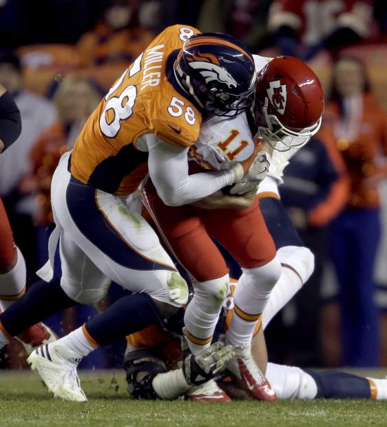 Kansas City Chiefs quarterback Alex Smith (11) is sacked by Denver Broncos outside linebacker Von Miller (58) during the first half of an NFL football game, Sunday, Nov. 27, 2016, in Denver. (AP Photo/Joe Mahoney)