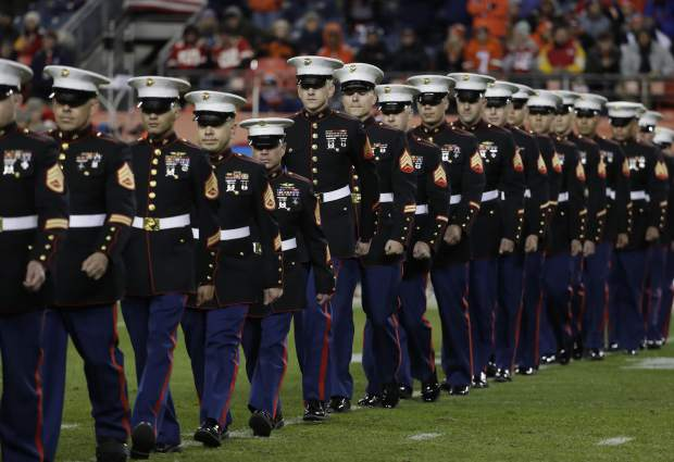 U.S. Marines are recognized at half time of an NFL football game between the Kansas City Chiefs and the Denver Broncos, Sunday, Nov. 27, 2016, in Denver. (AP Photo/Jack Dempsey)