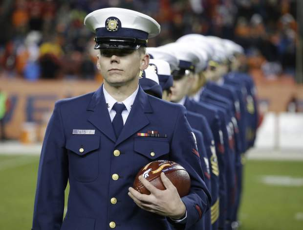 U.S Coast Guard personal are recognized at half time of an NFL football game between the Kansas City Chiefs and the Denver Broncos, Sunday, Nov. 27, 2016, in Denver. (AP Photo/Jack Dempsey)