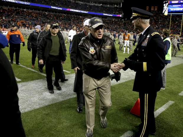Veterans are recognized at half time of an NFL football game between the Kansas City Chiefs and the Denver Broncos, Sunday, Nov. 27, 2016, in Denver. (AP Photo/Jack Dempsey)
