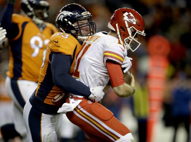 Kansas City Chiefs quarterback Alex Smith (11) is sacked by Denver Broncos defensive end Jared Crick (93) during the second half of an NFL football game, Sunday, Nov. 27, 2016, in Denver. (AP Photo/Joe Mahoney)