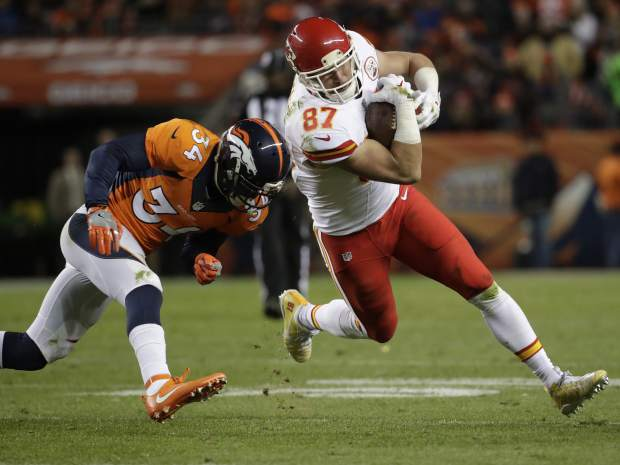 Kansas City Chiefs tight end Travis Kelce (87) runs as Denver Broncos defensive back Will Parks (34) pursues during the second half of an NFL football game, Sunday, Nov. 27, 2016, in Denver. (AP Photo/Jack Dempsey)