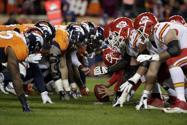 The Kansas City Chiefs and the Denver Broncos line up during the second half of an NFL football game, Sunday, Nov. 27, 2016, in Denver. (AP Photo/Jack Dempsey)