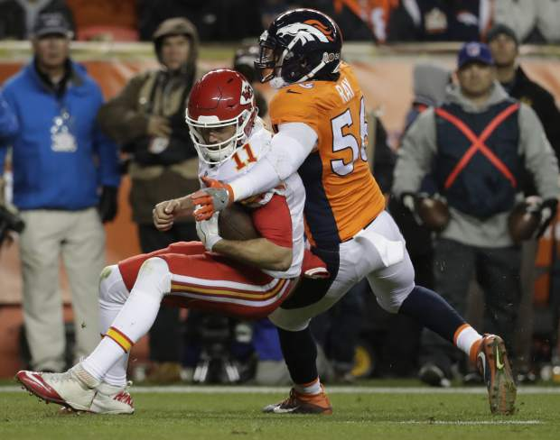 Kansas City Chiefs quarterback Alex Smith (11) is tackled by Denver Broncos outside linebacker Shane Ray (56) during the second half of an NFL football game, Sunday, Nov. 27, 2016, in Denver. (AP Photo/Jack Dempsey)