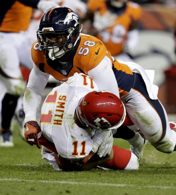 Kansas City Chiefs quarterback Alex Smith (11) is sacked by Denver Broncos outside linebacker Von Miller (58) during the second half of an NFL football game, Sunday, Nov. 27, 2016, in Denver. (AP Photo/Jack Dempsey)