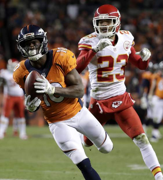 Denver Broncos wide receiver Emmanuel Sanders (10) pulls in a touchdown pass as Kansas City Chiefs cornerback Phillip Gaines (23) defends during the second half of an NFL football game, Sunday, Nov. 27, 2016, in Denver. (AP Photo/Jack Dempsey)