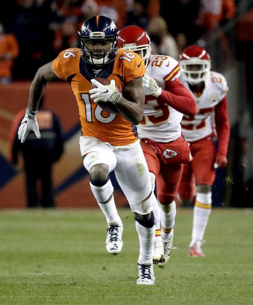 Denver Broncos wide receiver Bennie Fowler (16) runs back a touchdown catch as Kansas City Chiefs cornerback Phillip Gaines (23) defends during the second half of an NFL football game, Sunday, Nov. 27, 2016, in Denver. (AP Photo/Jack Dempsey)