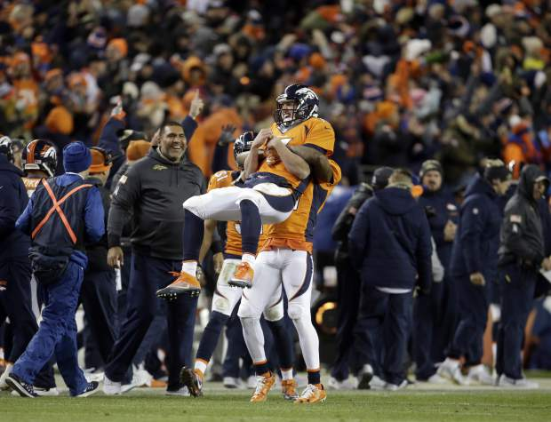 Denver Broncos cornerback Aqib Talib lifts quarterback Trevor Siemian (13) to celebrate Siemian's touchdown pass against the Kansas City Chiefs during the second half of an NFL football game, Sunday, Nov. 27, 2016, in Denver. (AP Photo/Joe Mahoney)