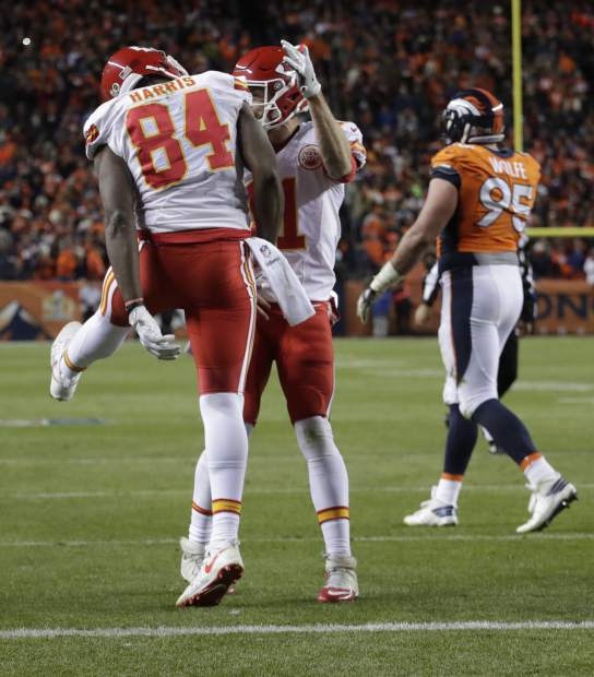 Kansas City Chiefs tight end Demetrius Harris (84) celebrates his two-point conversion catch with Alex Smith during the second half of an NFL football game against the Denver Broncos, Sunday, Nov. 27, 2016, in Denver. (AP Photo/Jack Dempsey)
