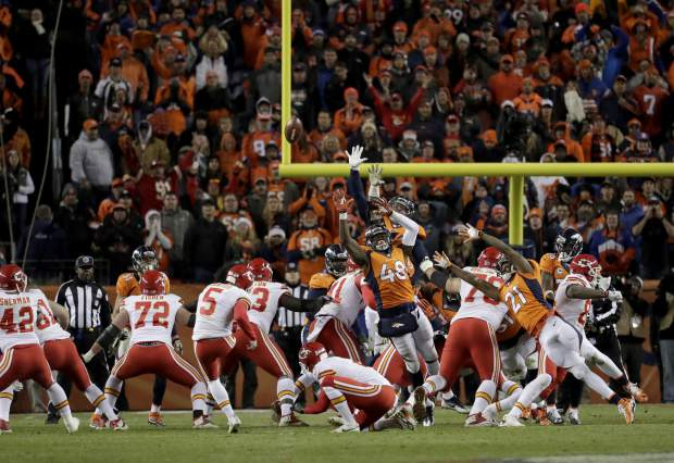 Kansas City Chiefs kicker Cairo Santos (5) kicks the game winning field goal as punter Dustin Colquitt (2) holds during overtime of an NFL football game against the Denver Broncos, Sunday, Nov. 27, 2016, in Denver. The Chiefs won 30-27 in overtime. (AP Photo/Jack Dempsey)