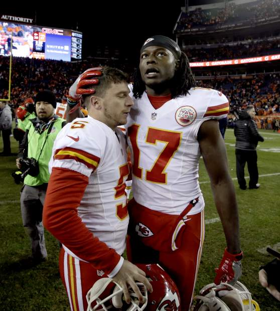 Kansas City Chiefs wide receiver Chris Conley (17) embraces kicker Cairo Santos (5) after an NFL football game against the Denver Broncos, Sunday, Nov. 27, 2016, in Denver. The Chiefs won 30-27 in overtime. (AP Photo/Joe Mahoney)