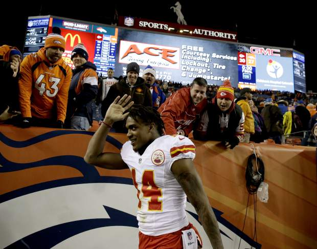 Kansas City Chiefs wide receiver Demarcus Robinson (14) waves to fans after an NFL football game against the Denver Broncos, Sunday, Nov. 27, 2016, in Denver. The Chiefs won 30-27 in overtime. (AP Photo/Jack Dempsey)