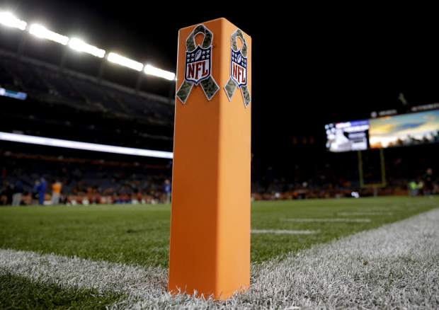 The NFL Salute to Service logo is shown on the end zone pylon prior to an NFL football game between the Kansas City Chiefs and the Denver Broncos, Sunday, Nov. 27, 2016, in Denver. (AP Photo/Jack Dempsey)