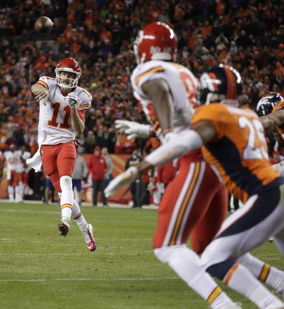Kansas City Chiefs quarterback Alex Smith (11) throws a two-point conversion to teammate Demetrius Harris (84) to tie the game as Denver Broncos cornerback Chris Harris (25) defends during the second half of an NFL football game, Sunday, Nov. 27, 2016, in Denver. (AP Photo/Jack Dempsey)