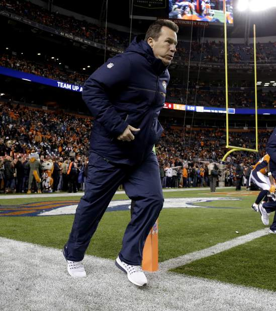 Denver Broncos head coach Gary Kubiak takes the field prior to an NFL football game against the Kansas City Chiefs, Sunday, Nov. 27, 2016, in Denver. (AP Photo/Jack Dempsey)
