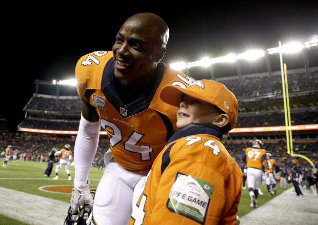 Denver Broncos outside linebacker DeMarcus Ware (94) poses with a fan prior to an NFL football game against the Kansas City Chiefs, Sunday, Nov. 27, 2016, in Denver. (AP Photo/Jack Dempsey)