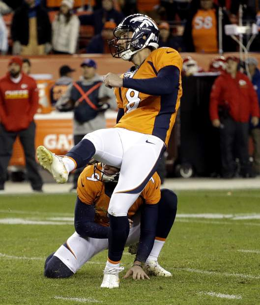 Denver Broncos kicker Brandon McManus (8) kicks a field goal during overtime of an NFL football game as punter Riley Dixon (9) holds against the Kansas City Chiefs, Sunday, Nov. 27, 2016, in Denver. (AP Photo/Jack Dempsey)
