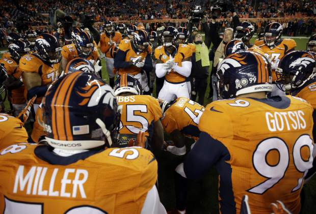 The Denver Broncos cheer prior to an NFL football game against the Kansas City Chiefs, Sunday, Nov. 27, 2016, in Denver. (AP Photo/Jack Dempsey)