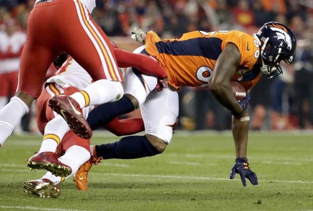 Denver Broncos wide receiver Demaryius Thomas (88) is hit by Kansas City Chiefs free safety Ron Parker during the first half of an NFL football game, Sunday, Nov. 27, 2016, in Denver. (AP Photo/Jack Dempsey)
