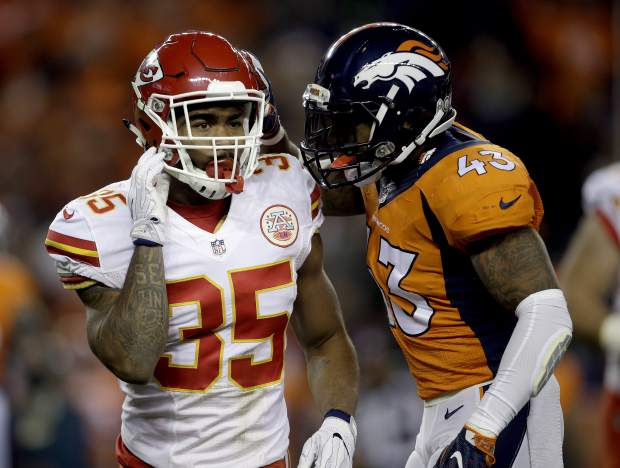 Denver Broncos strong safety T.J. Ward (43) and Kansas City Chiefs running back Charcandrick West (35) talk during the first half of an NFL football game, Sunday, Nov. 27, 2016, in Denver. (AP Photo/Joe Mahoney)