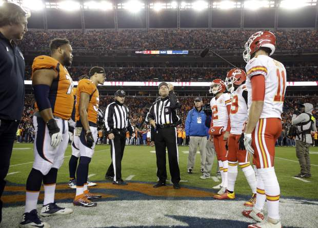 The Denver Broncos and the Kansas City Chiefs stand a mid field for the coin toss prior to an NFL football game, Sunday, Nov. 27, 2016, in Denver. (AP Photo/Jack Dempsey)