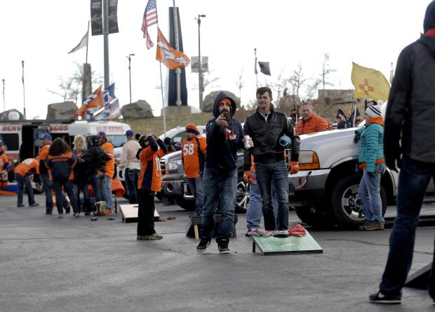 Denver Broncos fans play corn hole at Mile High Stadium prior to an NFL football game against the Kansas City Chiefs, Sunday, Nov. 27, 2016, in Denver. (AP Photo/Jack Dempsey)