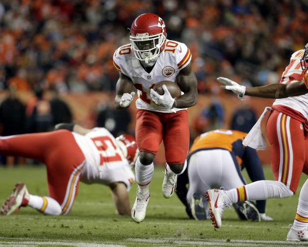 Kansas City Chiefs wide receiver Tyreek Hill (10) runs after the catch against the Denver Broncos during the first half of an NFL football game, Sunday, Nov. 27, 2016, in Denver. (AP Photo/Jack Dempsey)