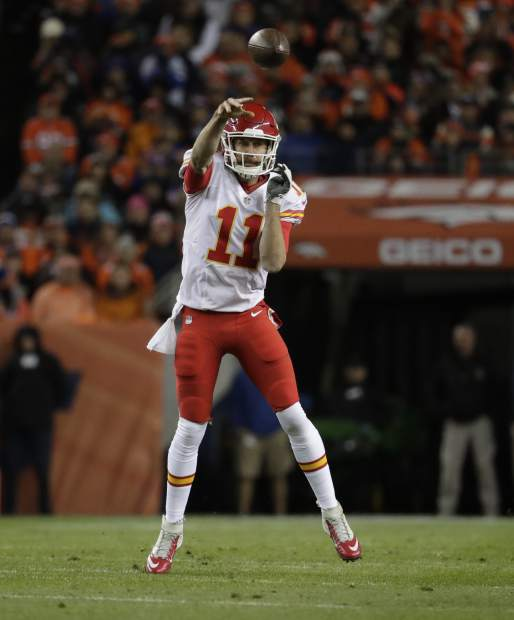 Kansas City Chiefs quarterback Alex Smith (11) throws against the Denver Broncos during the first half of an NFL football game, Sunday, Nov. 27, 2016, in Denver. (AP Photo/Jack Dempsey)