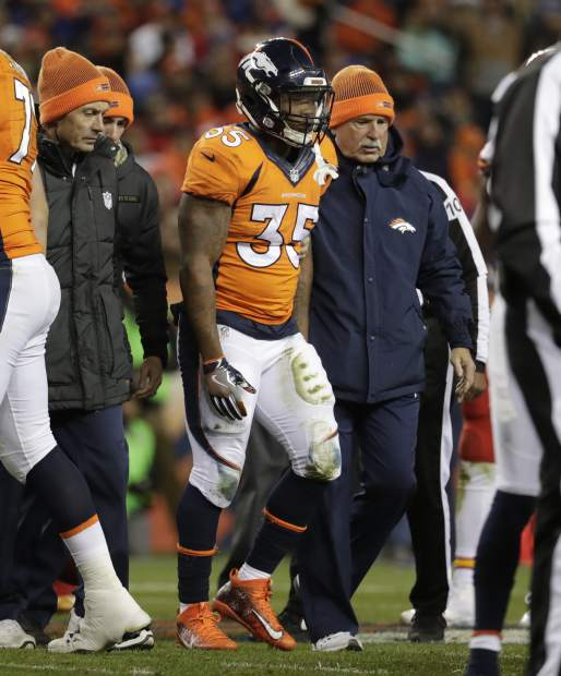 Denver Broncos running back Kapri Bibbs (35) is helped off the field after an injury during the first half of an NFL football game against the Kansas City Chiefs, Sunday, Nov. 27, 2016, in Denver. (AP Photo/Jack Dempsey)