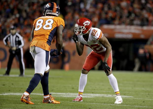 Kansas City Chiefs cornerback Marcus Peters (22) lines up against Denver Broncos wide receiver Demaryius Thomas (88) during the first half of an NFL football game, Sunday, Nov. 27, 2016, in Denver. (AP Photo/Jack Dempsey)