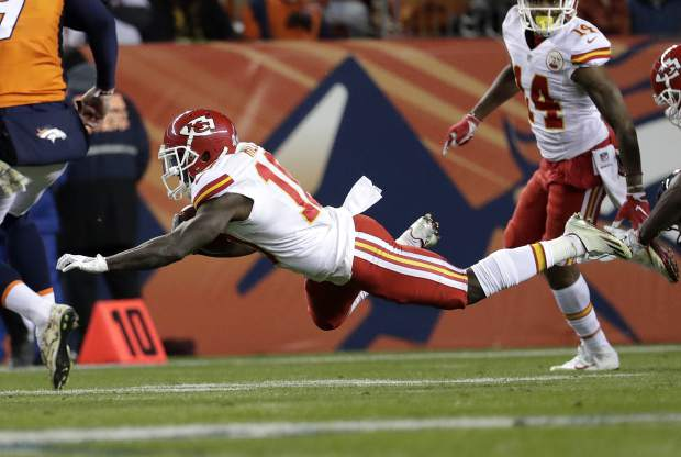 Kansas City Chiefs wide receiver Tyreek Hill (10) is tripped up against the Denver Broncos during the first half of an NFL football game, Sunday, Nov. 27, 2016, in Denver. (AP Photo/Jack Dempsey)