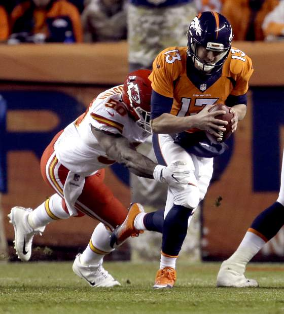 Denver Broncos quarterback Trevor Siemian (13) is sacked by Kansas City Chiefs outside linebacker Justin Houston (50) during the first half of an NFL football game, Sunday, Nov. 27, 2016, in Denver. (AP Photo/Joe Mahoney)