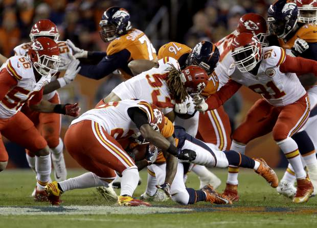 Denver Broncos running back Kapri Bibbs (35) collides with Kansas City Chiefs strong safety Eric Berry during the first half of an NFL football game, Sunday, Nov. 27, 2016, in Denver. (AP Photo/Joe Mahoney)