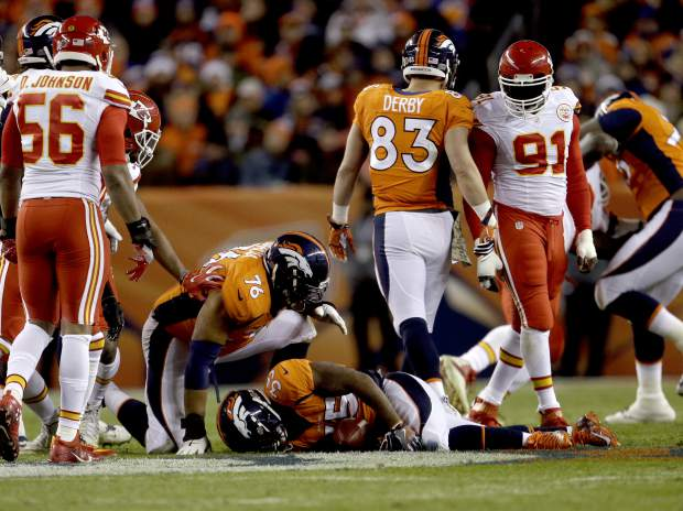 Denver Broncos running back Kapri Bibbs (35) lies on the turf after being injured against the Kansas City Chiefs during the first half of an NFL football game, Sunday, Nov. 27, 2016, in Denver. (AP Photo/Joe Mahoney)