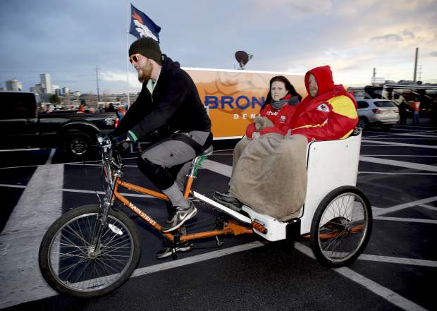 Kansas City Chiefs fans arrive at Mile High Stadium prior to an NFL football game against the Denver Broncos, Sunday, Nov. 27, 2016, in Denver. (AP Photo/Jack Dempsey)