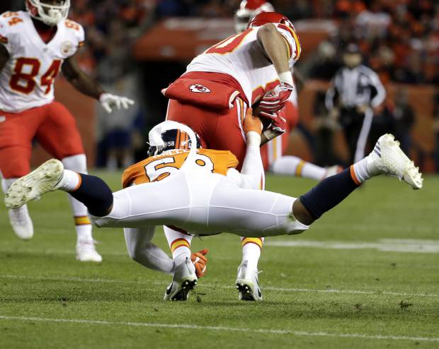 Denver Broncos outside linebacker Von Miller (58) pulls down Kansas City Chiefs wide receiver Tyreek Hill (10) during the first half of an NFL football game, Sunday, Nov. 27, 2016, in Denver. (AP Photo/Jack Dempsey)