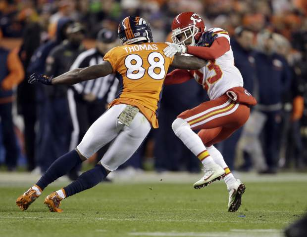 Denver Broncos wide receiver Demaryius Thomas (88) knocks over Kansas City Chiefs cornerback Phillip Gaines (23) during the first half of an NFL football game, Sunday, Nov. 27, 2016, in Denver. (AP Photo/Joe Mahoney)