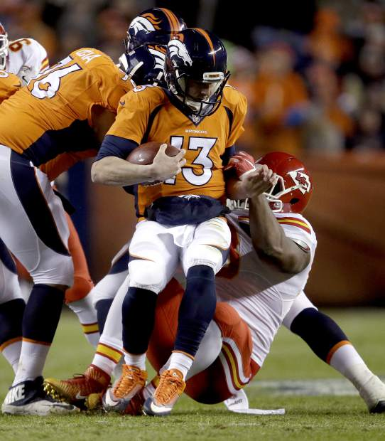 Denver Broncos quarterback Trevor Siemian (13) is sacked by Kansas City Chiefs defensive tackle Kendall Reyes during the first half of an NFL football game, Sunday, Nov. 27, 2016, in Denver. (AP Photo/Joe Mahoney)