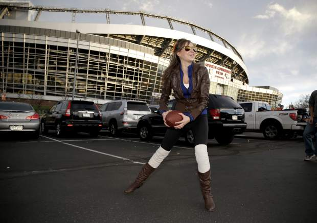 Mikaela Kingsted plays football outside Mile High Stadium prior to an NFL football game between the Kansas City Chiefs and the Denver Broncos, Sunday, Nov. 27, 2016, in Denver. (AP Photo/Jack Dempsey)