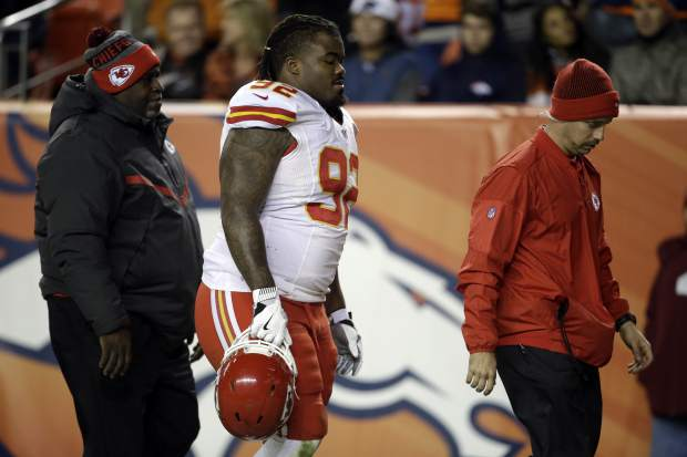 Kansas City Chiefs nose tackle Dontari Poe (92) leaves the field after an injury against the Denver Broncos during the first half of an NFL football game, Sunday, Nov. 27, 2016, in Denver. (AP Photo/Joe Mahoney)