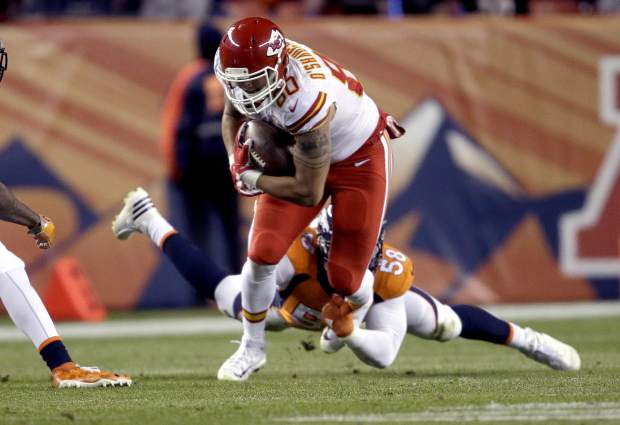 Kansas City Chiefs tight end James O'Shaughnessy (80) is tackled by Denver Broncos outside linebacker Von Miller during the first half of an NFL football game, Sunday, Nov. 27, 2016, in Denver. (AP Photo/Joe Mahoney)
