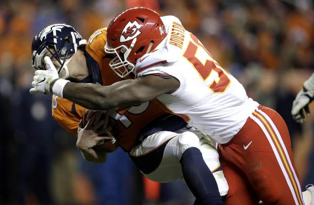 Kansas City Chiefs outside linebacker Justin Houston (50) sacks Denver Broncos quarterback Trevor Siemian (13) in the end zone for a safety during the first half of an NFL football game, Sunday, Nov. 27, 2016, in Denver. (AP Photo/Joe Mahoney)