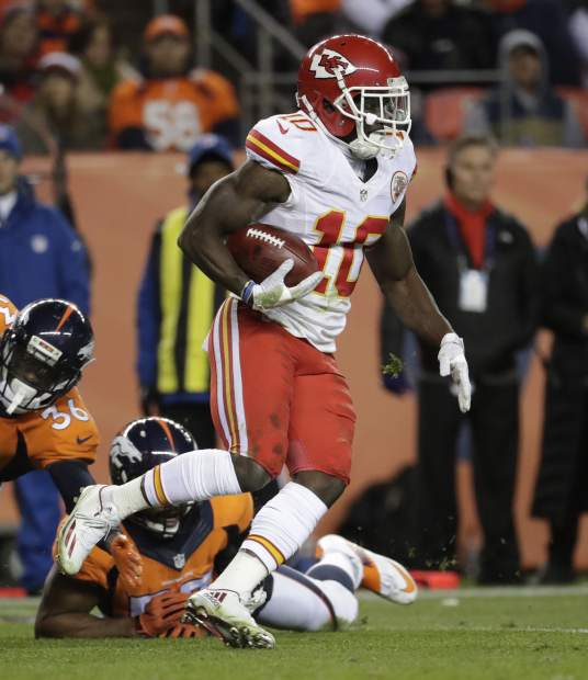 Kansas City Chiefs wide receiver Tyreek Hill (10) runs back a punt for a touchdown against the Denver Broncos during the first half of an NFL football game, Sunday, Nov. 27, 2016, in Denver. (AP Photo/Jack Dempsey)