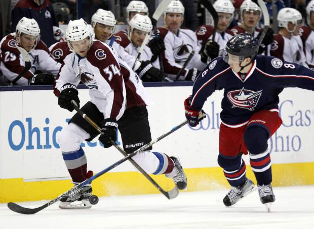 Colorado Avalanche forward Carl Soderberg, left, of Sweden, works for the puck against Columbus Blue Jackets defenseman Zach Werenski during the first period of an NHL hockey game in Columbus, Ohio, Monday, Nov. 21, 2016. (AP Photo/Paul Vernon)