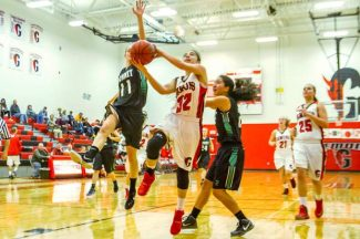 Glenwood Springs freshman Ximena Gutierrez(32) goes for the layup during Thursday night's game against the Summit Tigers defense.