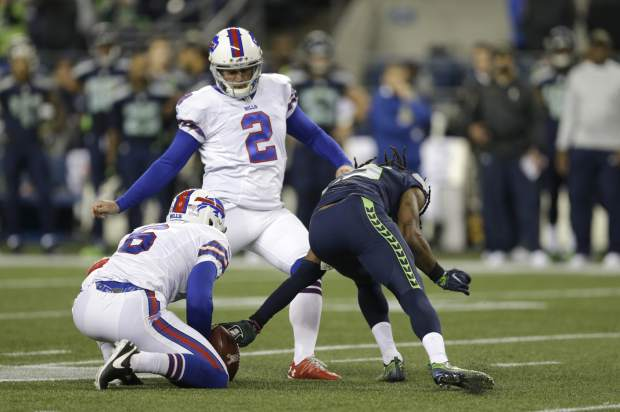 Seattle Seahawks cornerback Richard Sherman, right, reaches out to grab the ball on a failed field goal attempt by Buffalo Bills kicker Dan Carpenter (2) as Colton Schmidt holds in the first half of an NFL football game, Monday, Nov. 7, 2016, in Seattle. Sherman was given a defensive offsides penalty on the play. (AP Photo/John Froschauer)